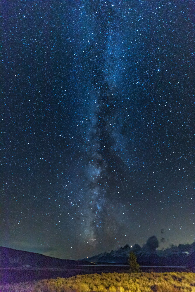 As vast as the Teton range and surrounding valley feel in daytime a whole new perspective emerges under the milky way.