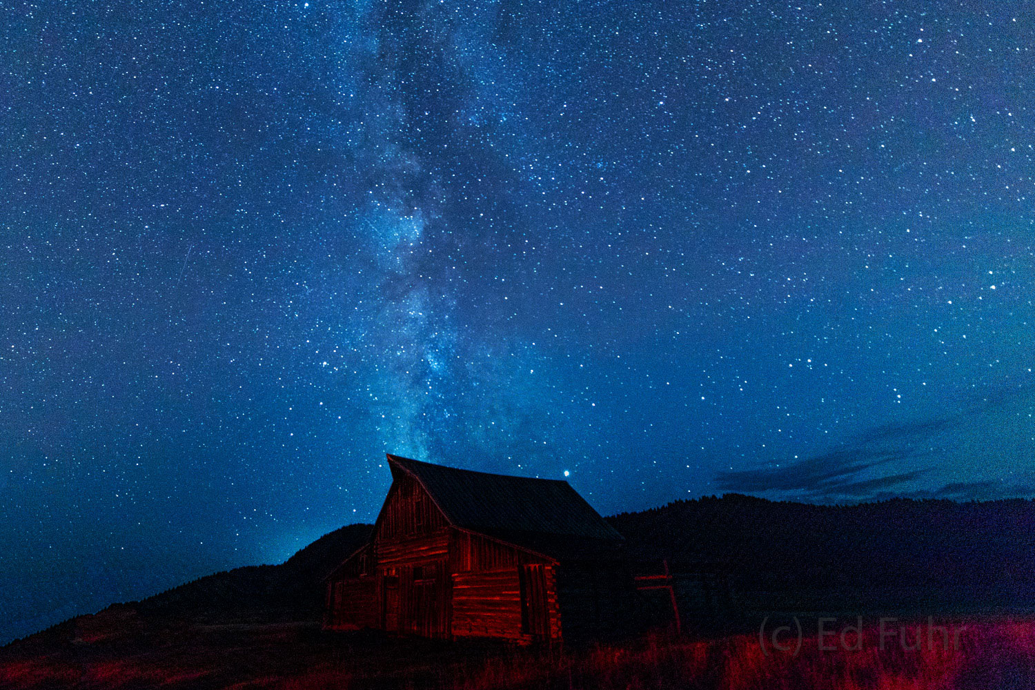 The milky way rises above the Moulton Barn, built more than a century ago, by settling Mormons.