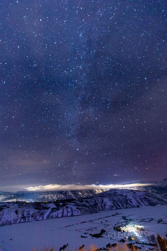 The milky way spans over the Jackson Hole valley.