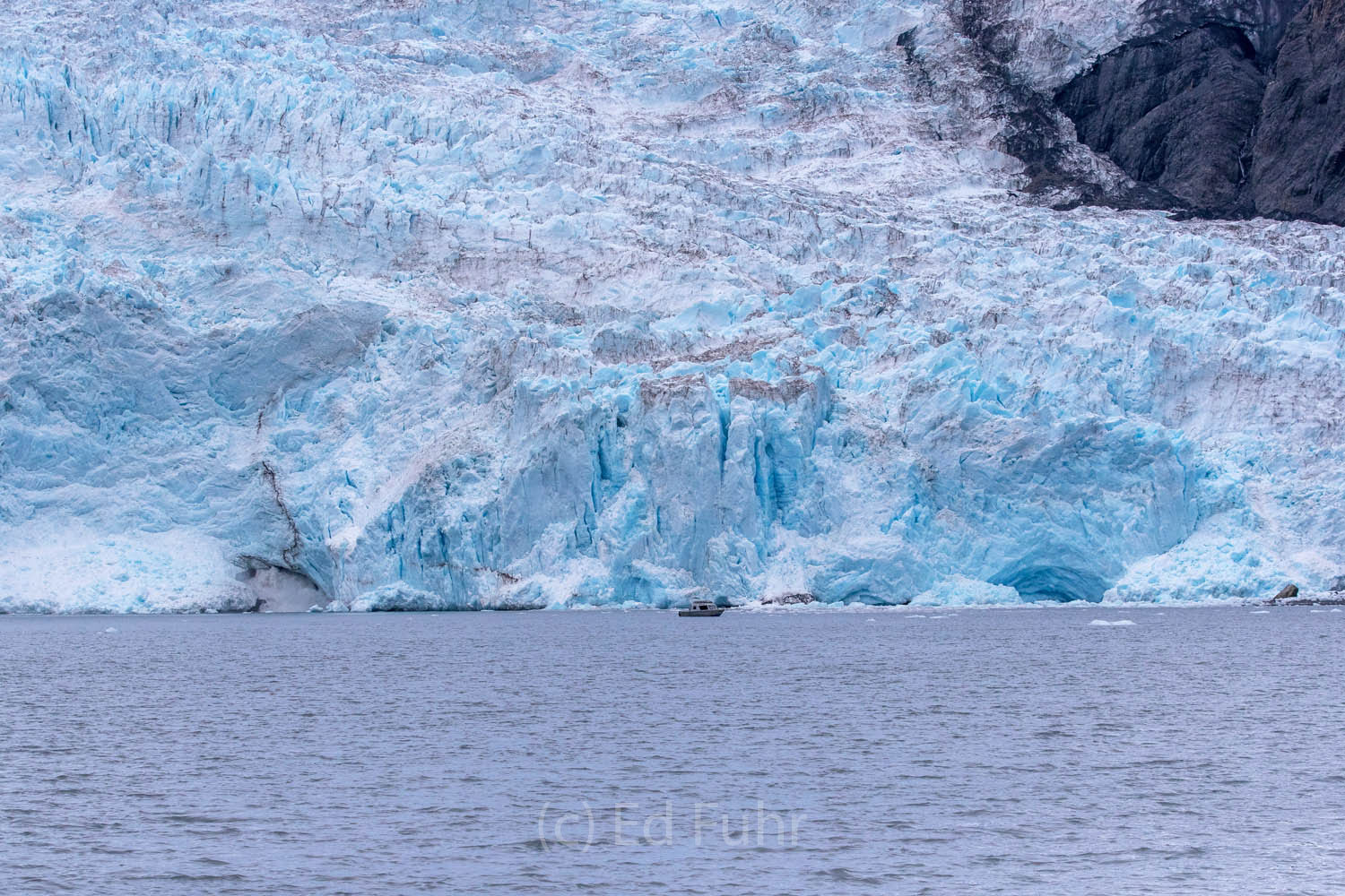 Below this glacier, actually one of the smaller ones in Aialik Bay, water rushes through an opening and into the sea.