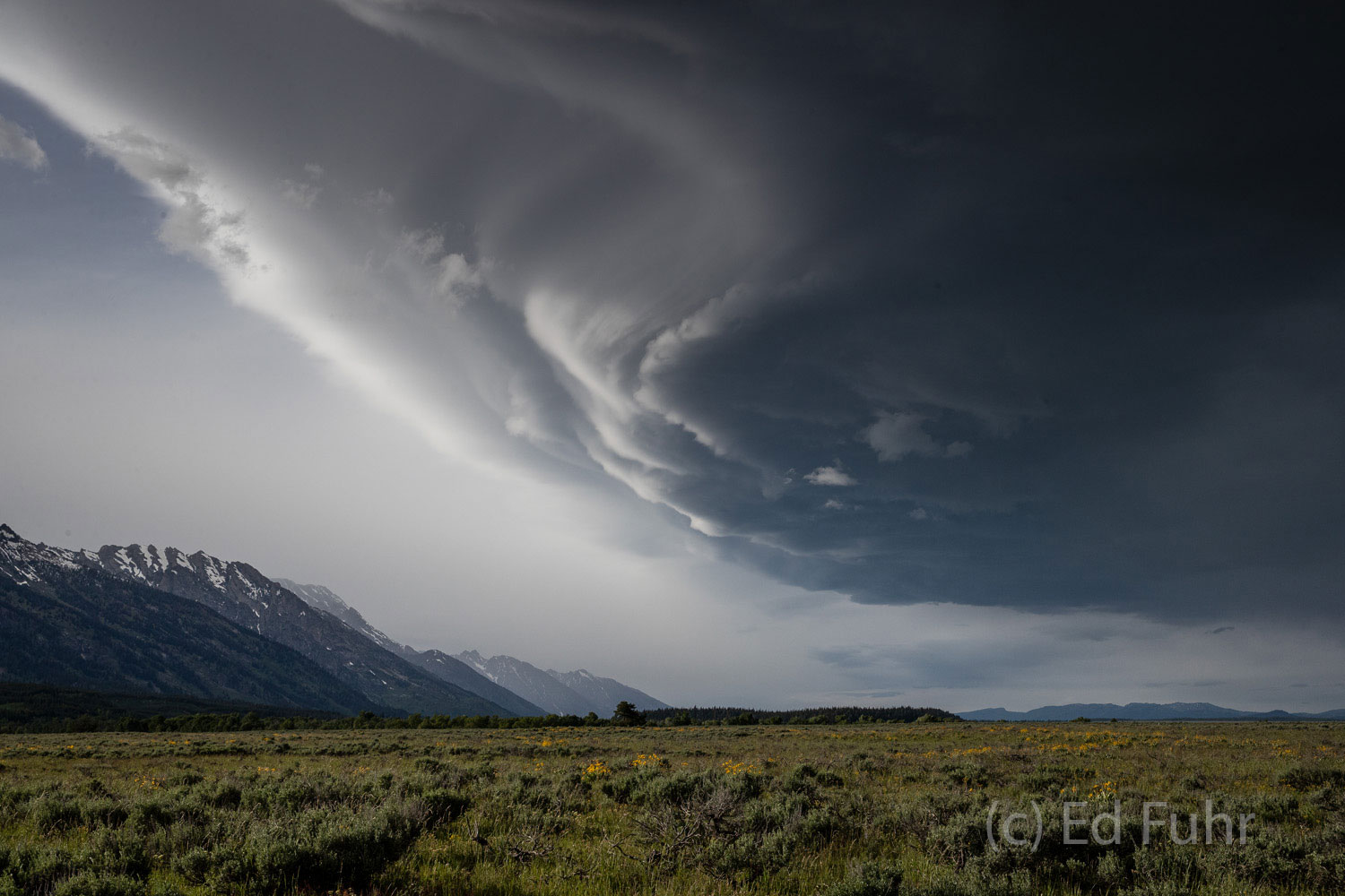 A powerful thunderstorm cell sweeps over the Teton range and across the valley floor.