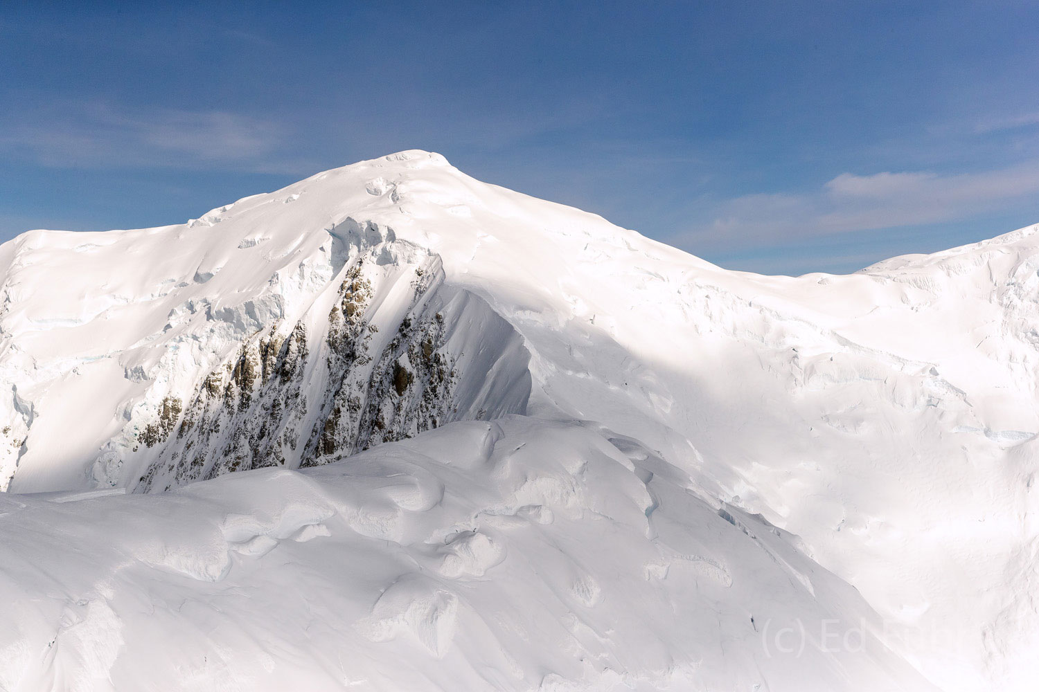 Heavy snows are loaded on the western face of the ridges leading to Denali's peaks