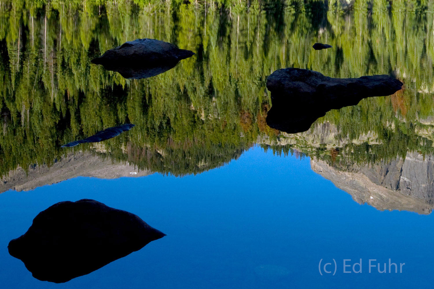 Hallet's Peak reflects in the still waters of Bear Lake