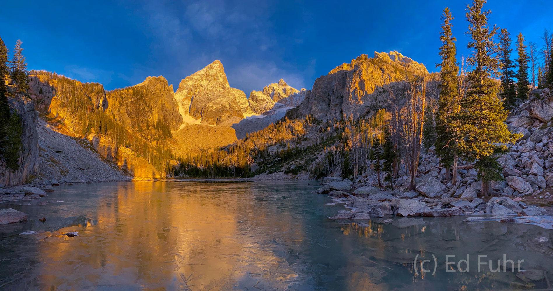 A panoramic sweep at this alpine lake at sunrise.