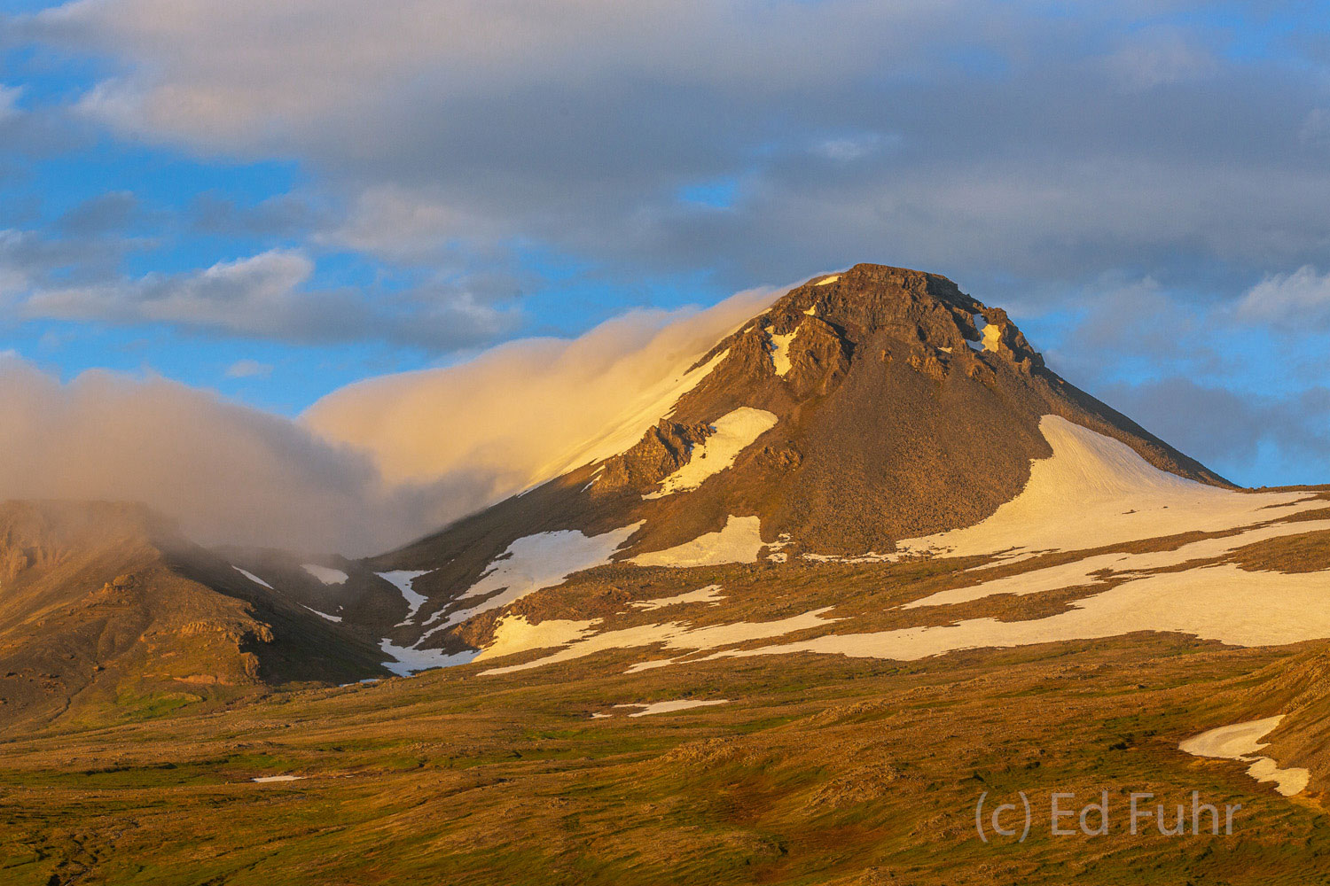 A warm light belies the cold and snow that still embrace much of the wild lands of Snaefellsness National Park.