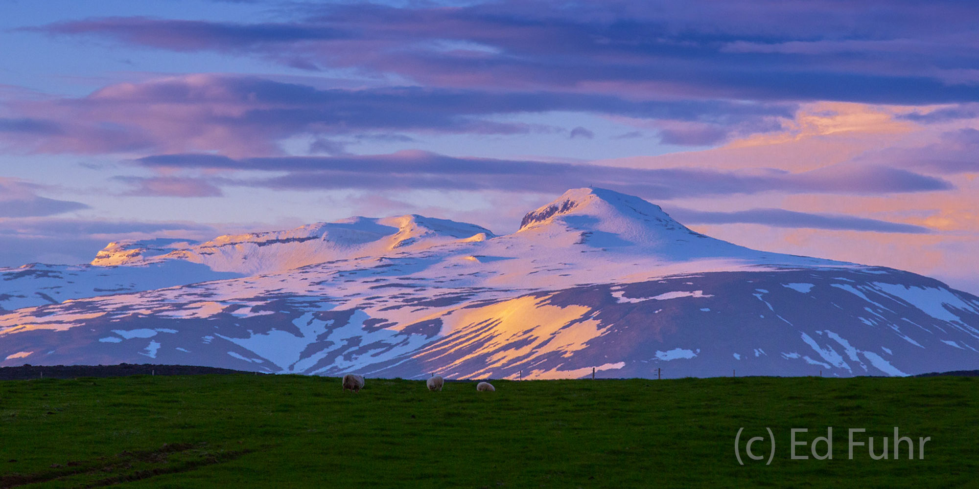A magical sunset bathes Langokull in a sweet mix of purples, pinks and magentas, providing encouragement for a tired driver at...