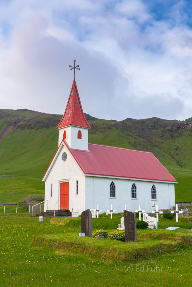 Not far from the desolate black sand beaches is a remarkable sign of hope, Reyniskirkja Church.
