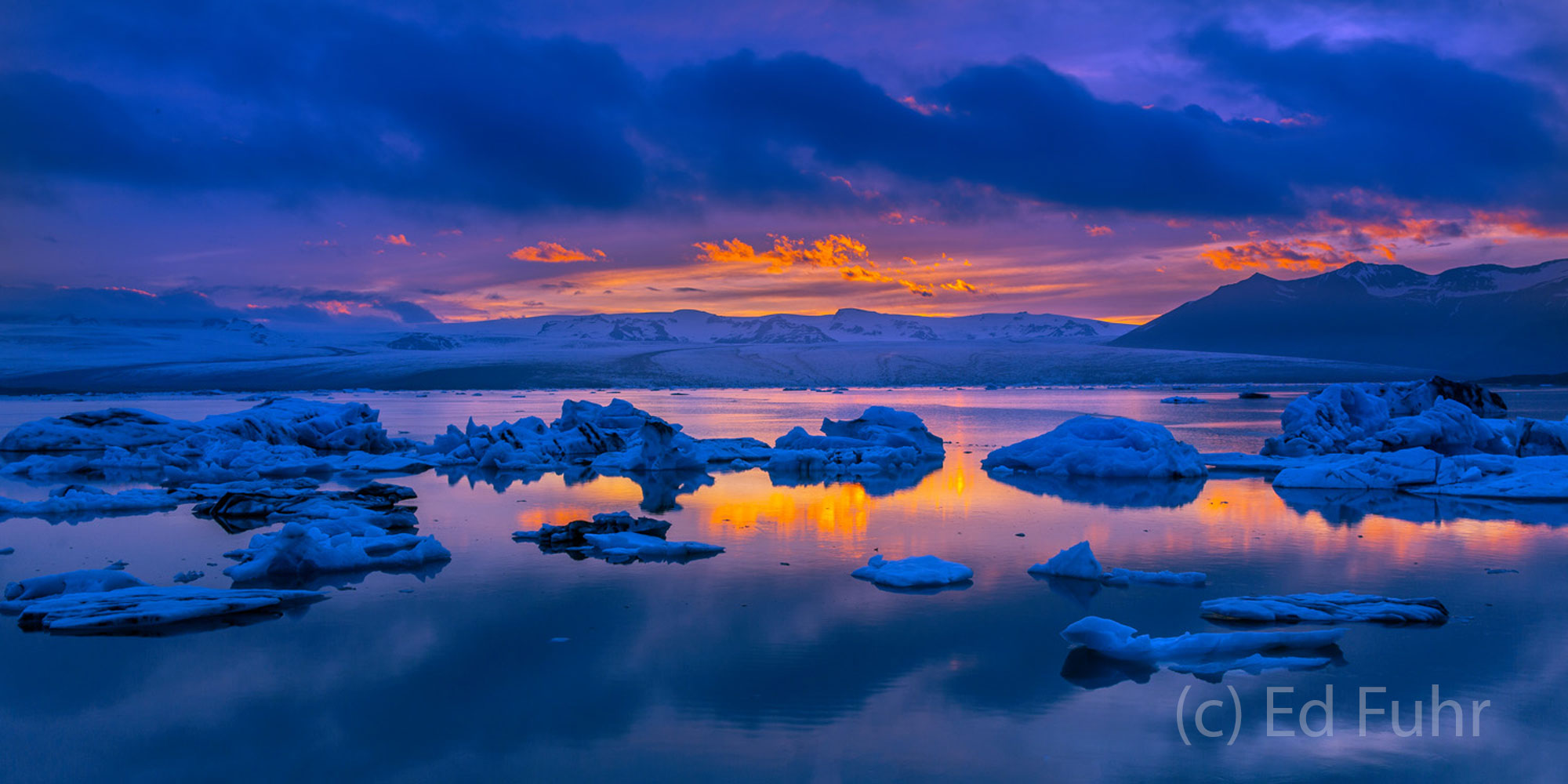 One of the most eerie and moving scenes I have ever witnessed, here lies Jokulsarlon lagoon at sunset.   Hundreds of icebergs...
