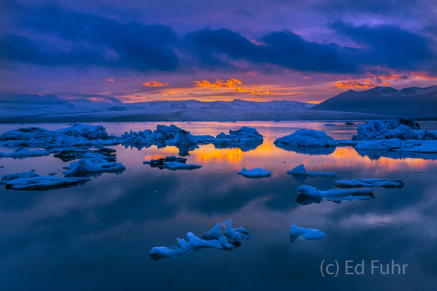 Beyond Jokulsarlon lagoon rises the glacier-covered mountains from which these icebergs have come.   It is well past midnight...