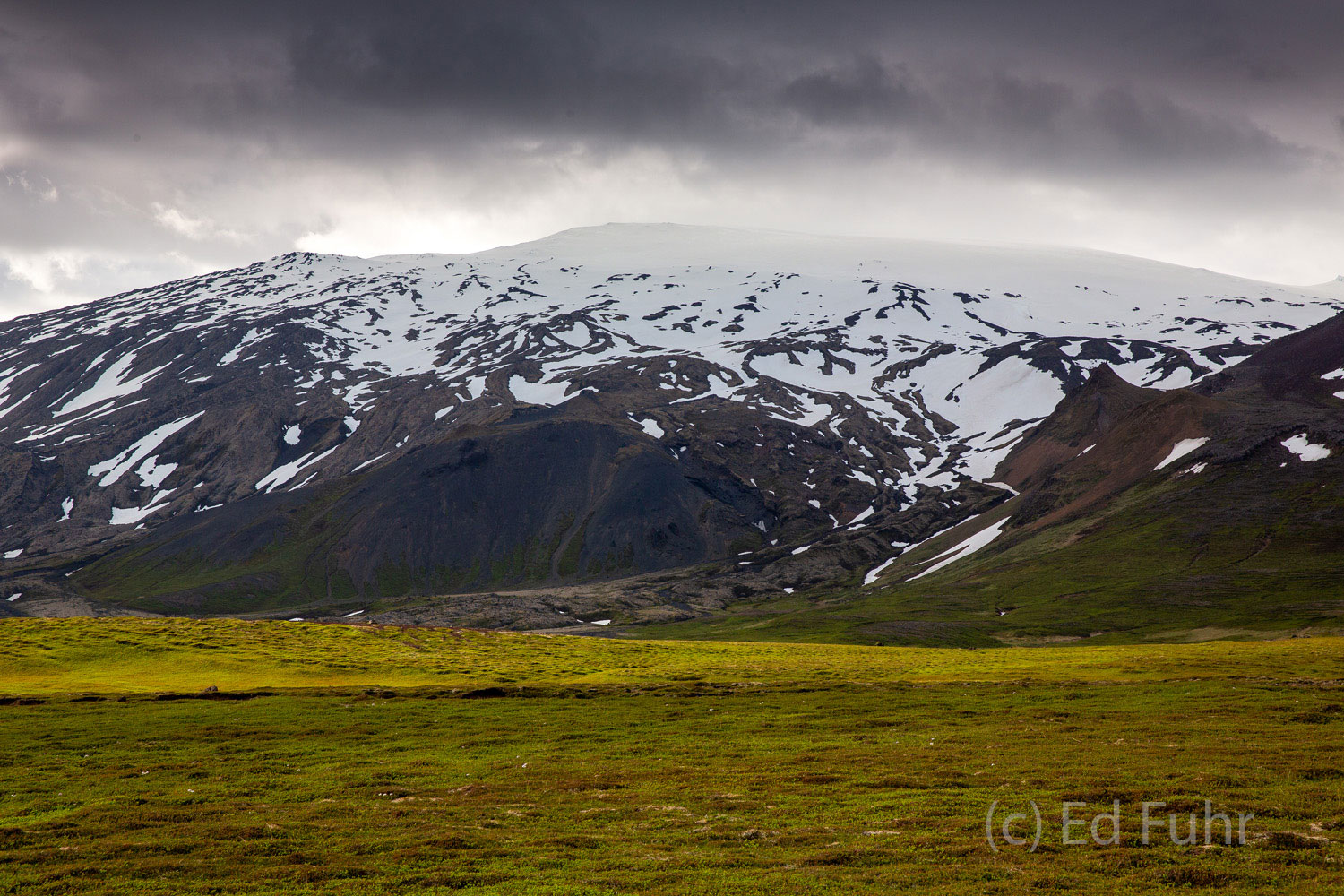 On Iceland even mid summer offers many reminders that winter and cold and ice are never really far away, especially near the...