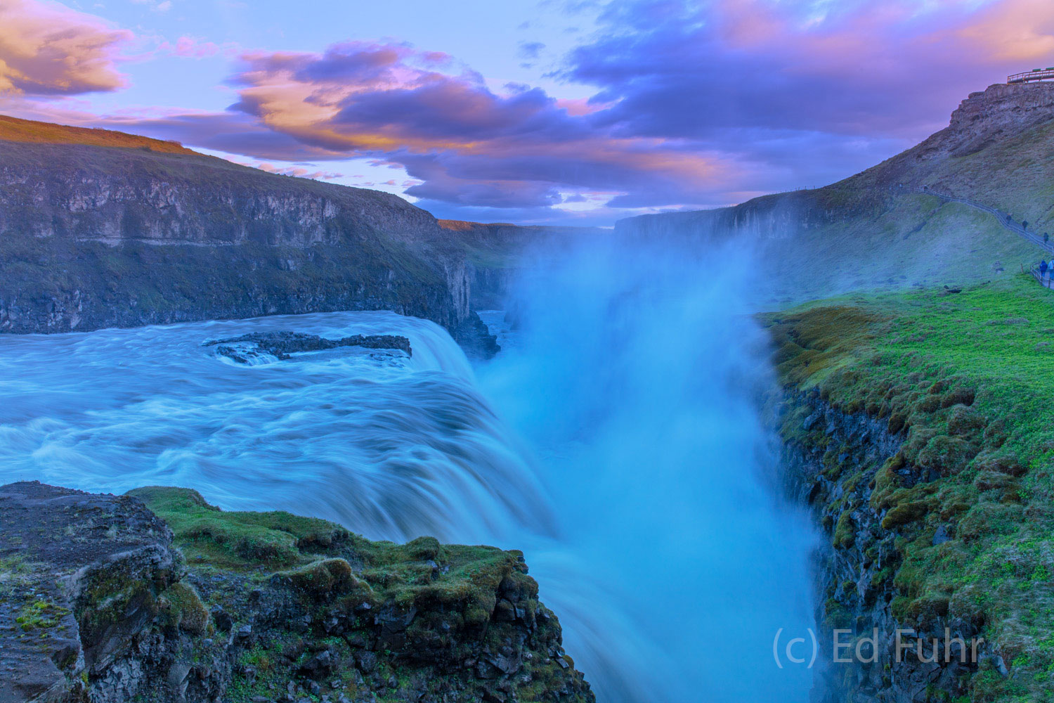As the waters roar at Gullfoss, sunset colors the skies above.