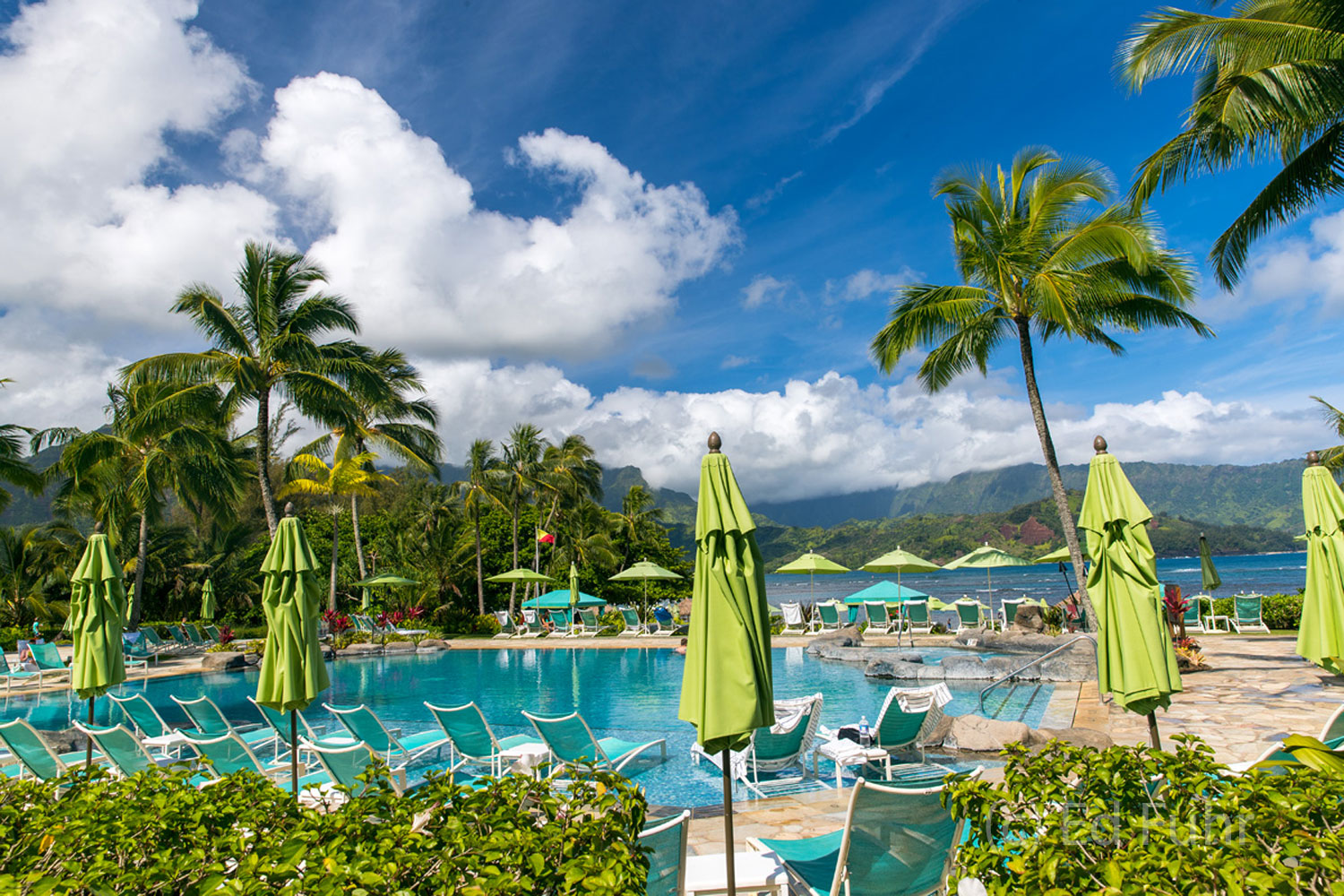 From the St. Regis, a sweeping view of beaches, pools, Honalei Bay and the Kauai mountains.