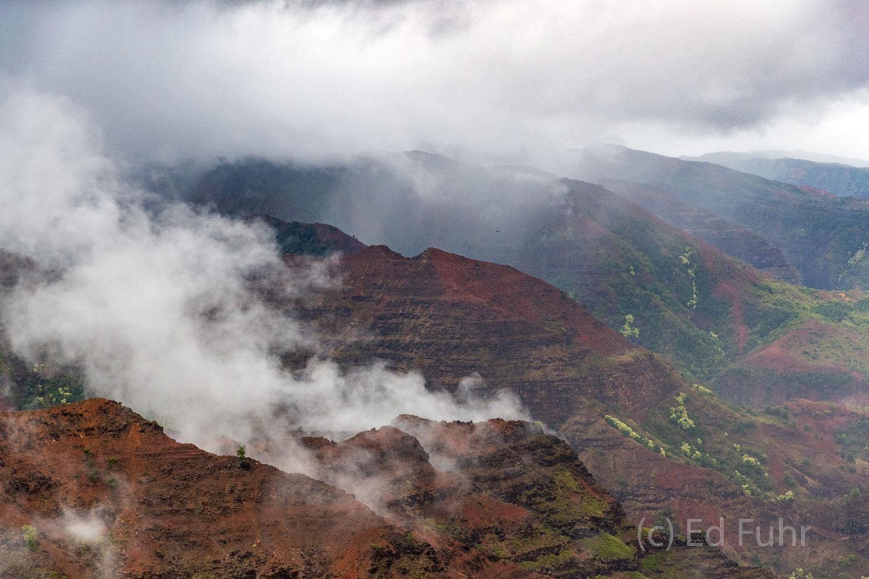 A passing storm clears the peaks above Waimea Canyon.