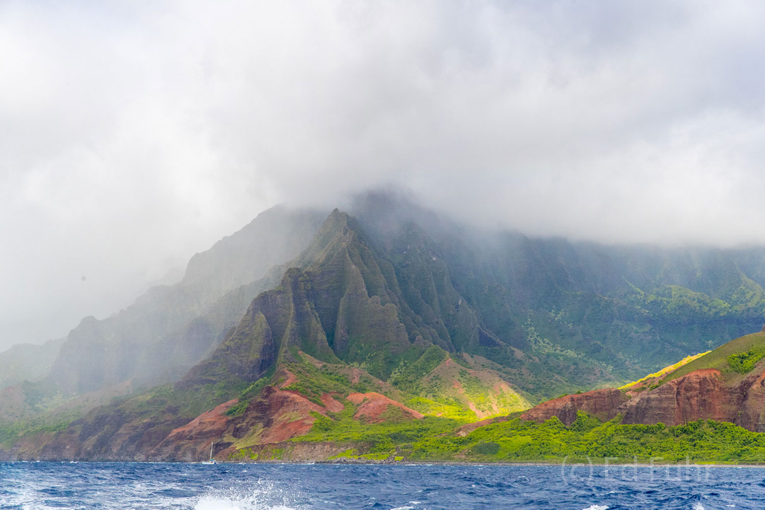 Sailing past Kauai's Na Pali coastline is the only way to appreciate and really see its rich colors, size and splendor.