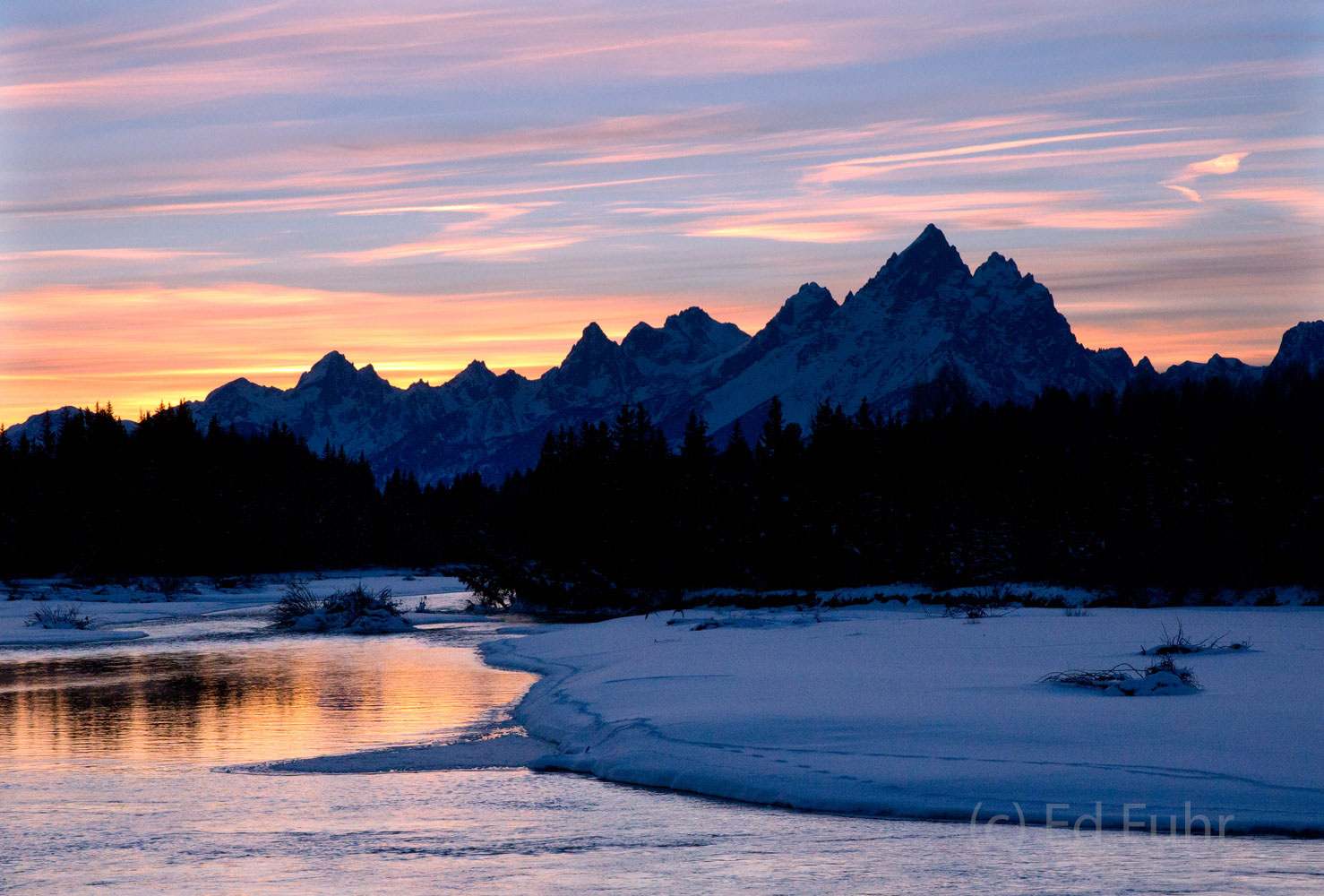 The last light of dusk reflects on the still open waters of the Snake River near Buffalo Fork.