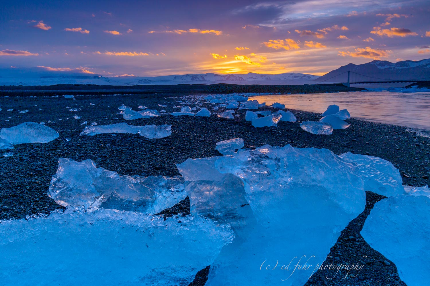 On Iceland's south coast, icebergs fill the Jökulsárlón glacier lagoon, only to wash up on the shore of Diamond Beach, creating...