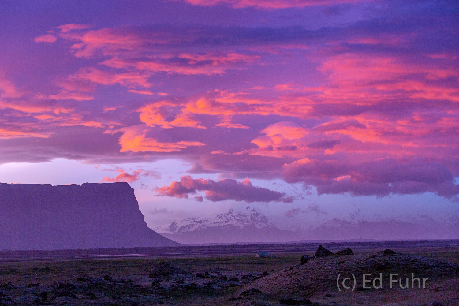 Before sunrise, the Iceland summer sky can light in stunning shades of magenta and purple and, because its latitude, Icelandic...