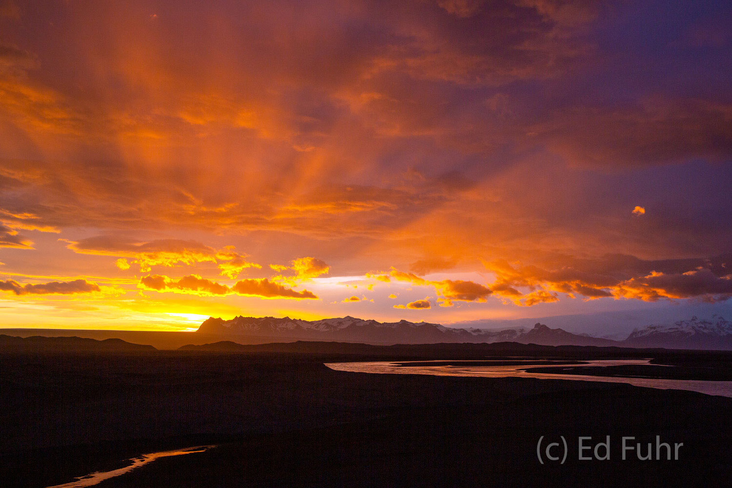 In midsummer, sunrises and sunsets last hours.  Here a 3:00 a.m.  spectacular sunrise bursts on the Iceland horizon.