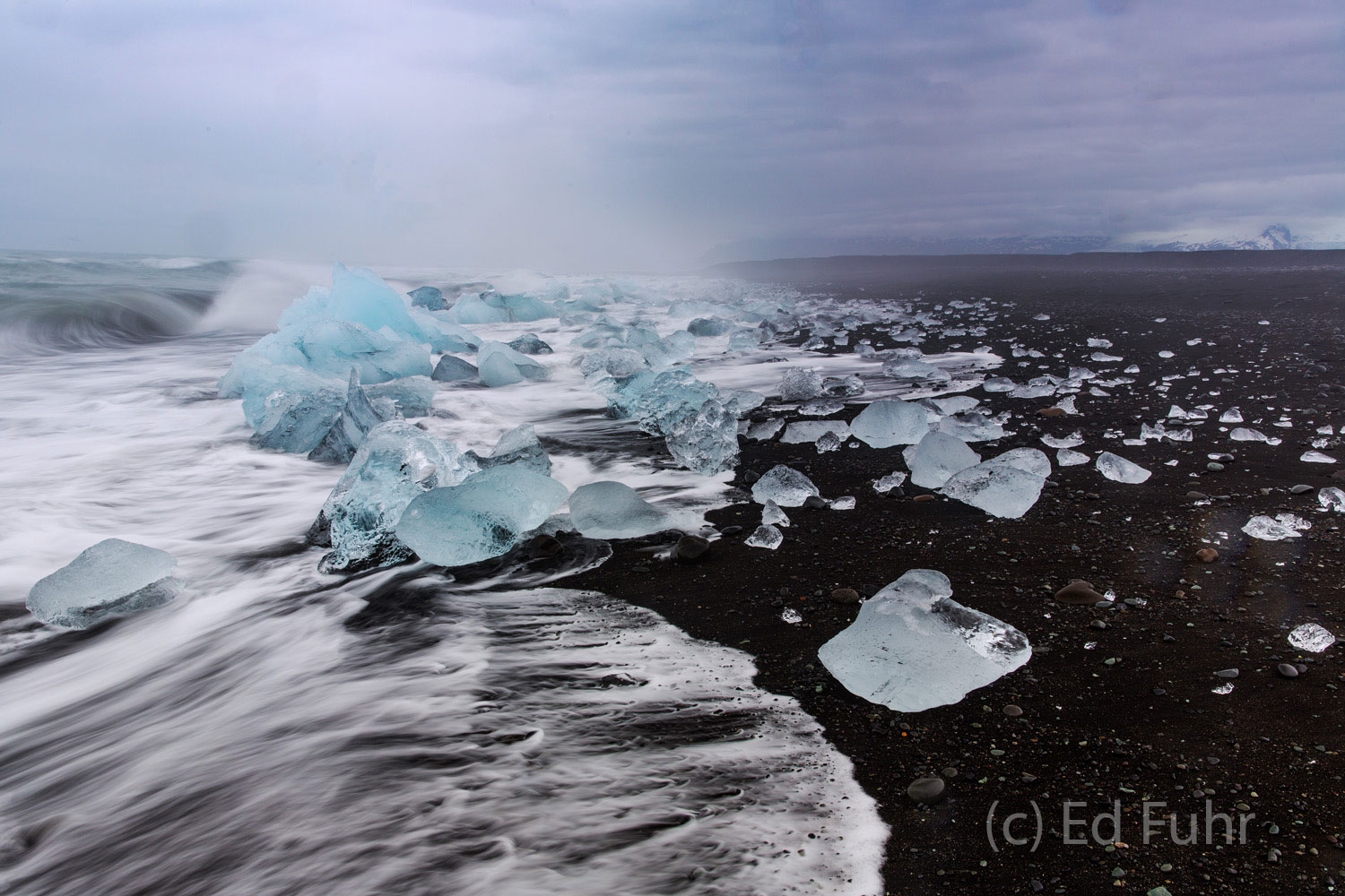 The perpetual winds that whip across the Iceland landscape drive powerful waves onto this icy shore.