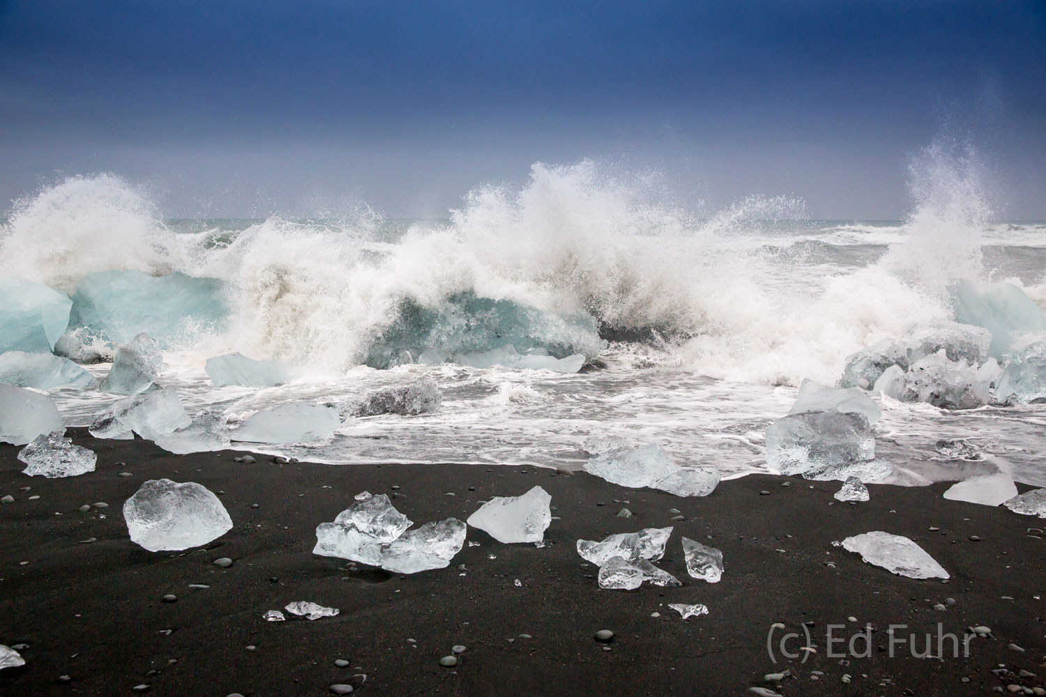 A powerful storm kicks up massive waves that pulverize these once mighty icebergs.