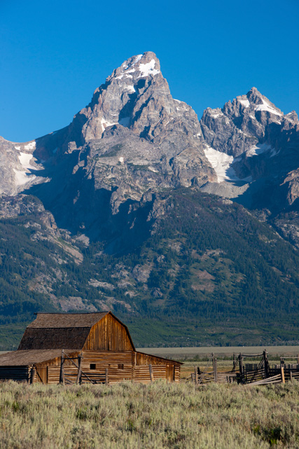 Grand Teton frames one of the early farming homesteads built by Mormons during their migration west more than a century ago.&...