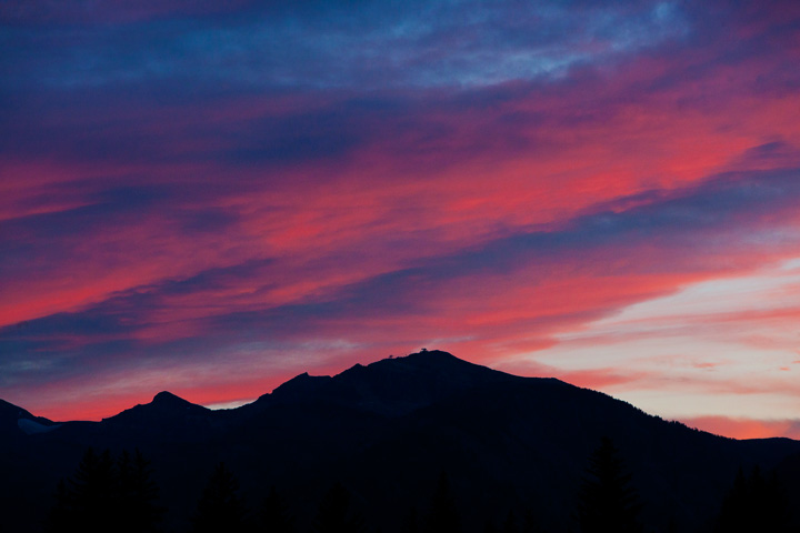 A briliant sunset silhouettes the Tetons and the sublette ski lift.
