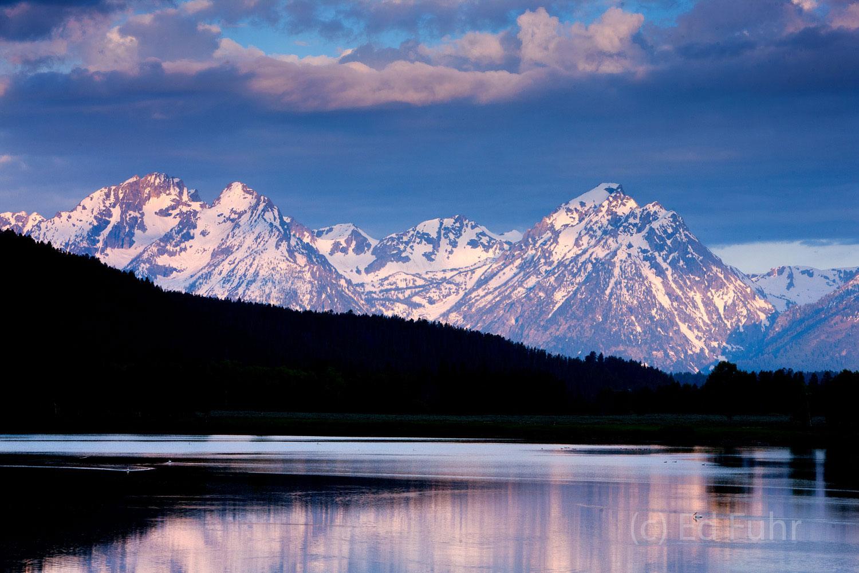 Snow-capped peaks of the Teton mountain range rise above the slopes of Signal Mountain.