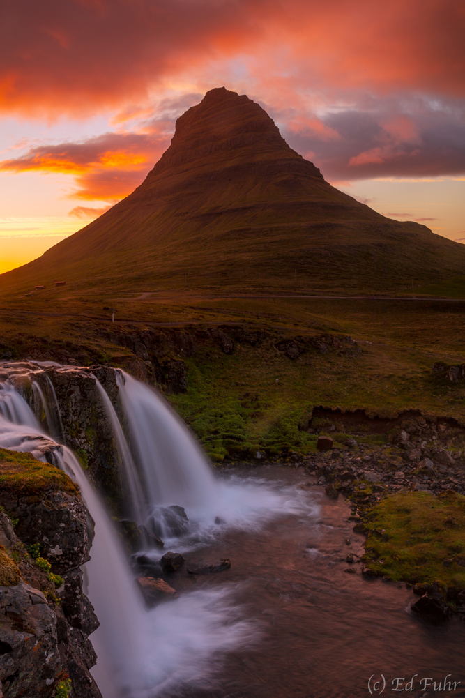 Under the glow of a never ending midnight sun, the spectacular double falls of Kirkjufellsfoss and the indomitable Mt. Kirkjufell...