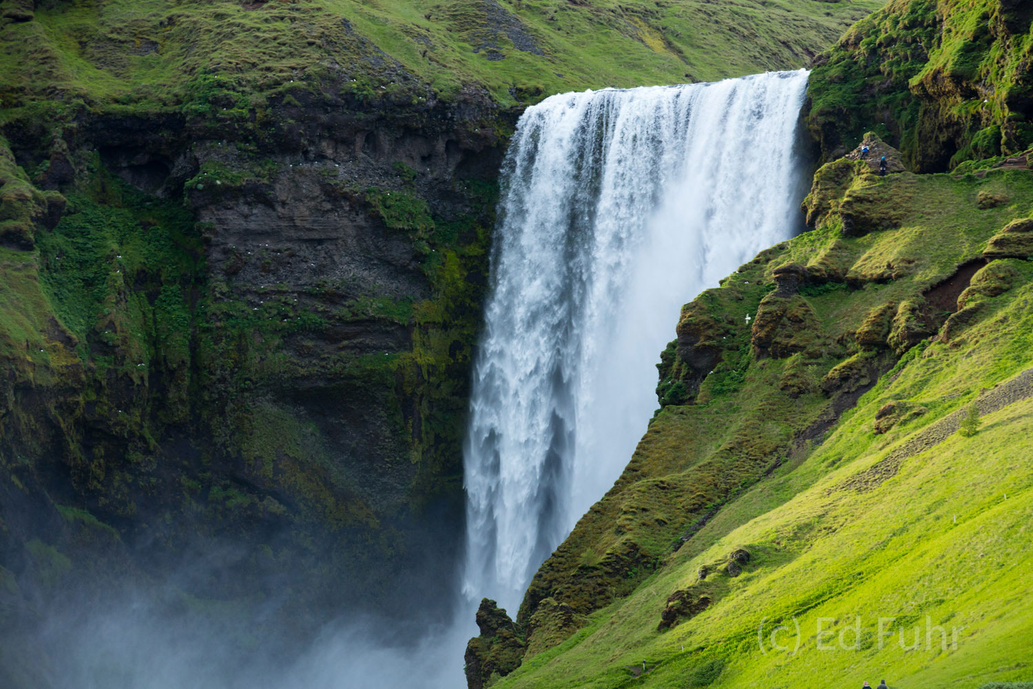 After the crowds had disappeared, the sun made a belated appeared late evening appearance, bathing the Skogafoss and its nearby...