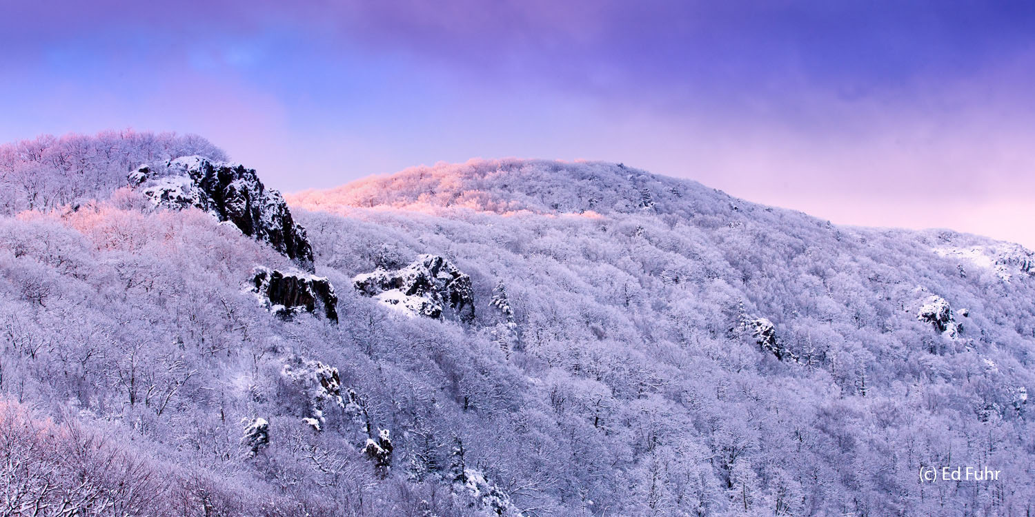 Just before sunrise, the wintry peaks of Little Stony Man Mountain reach to the purple pastels of a breaking dawn.